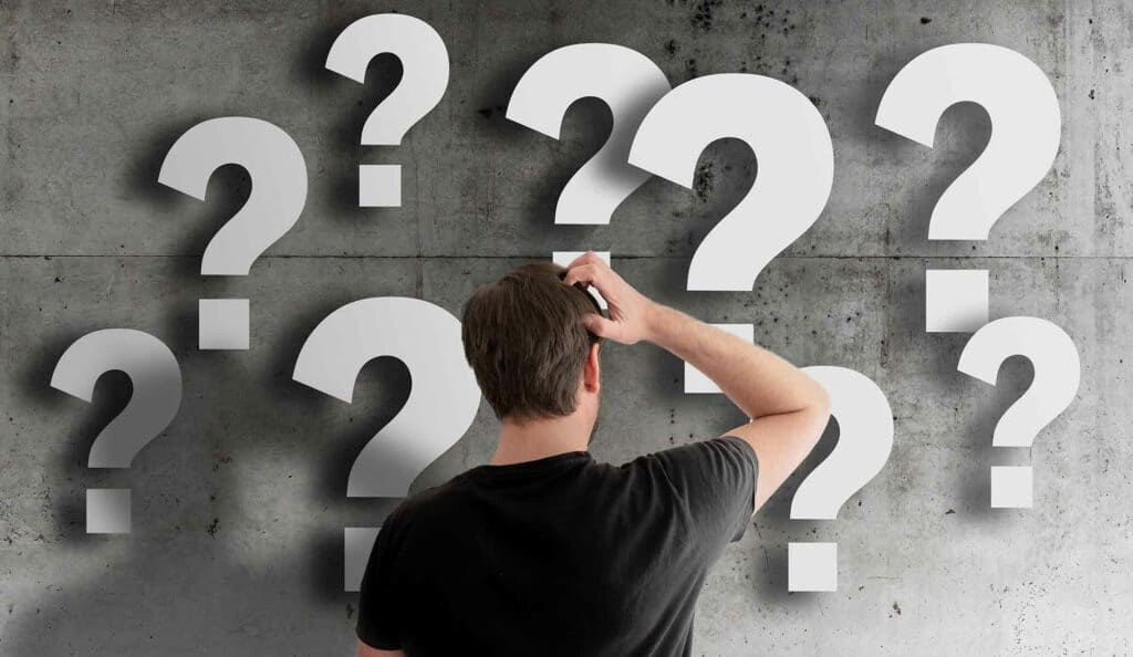 decorative man looking at question marks